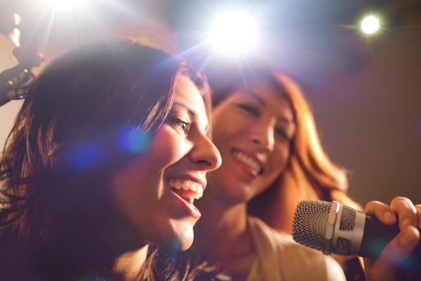 Two girls singing karoke