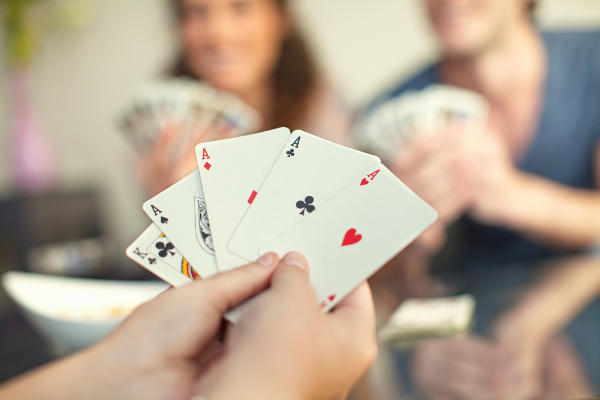 A close up of a hand of cards in a game of poker