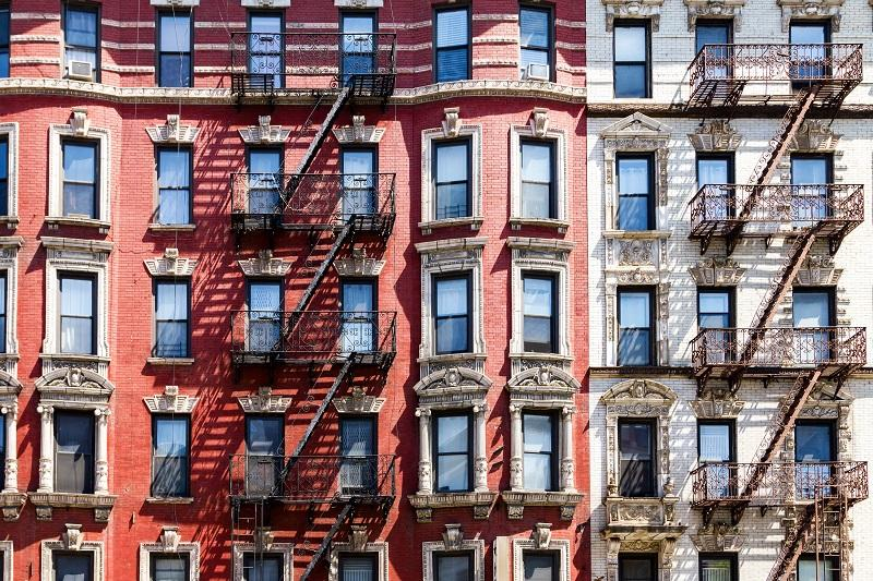 New York City historic apartment building windows and fire escapes in the East Village.