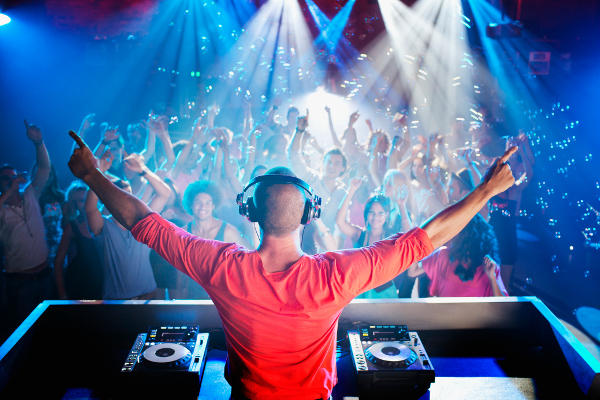 A DJ playing for a large crowd