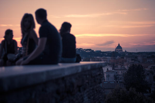 Young people watching sunset in Rome.