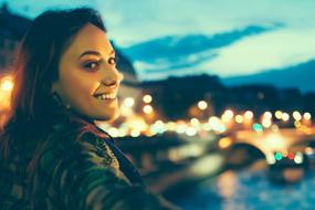 woman on bridge over river seine